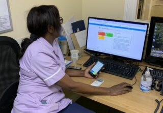 Care staff looking at an IT system